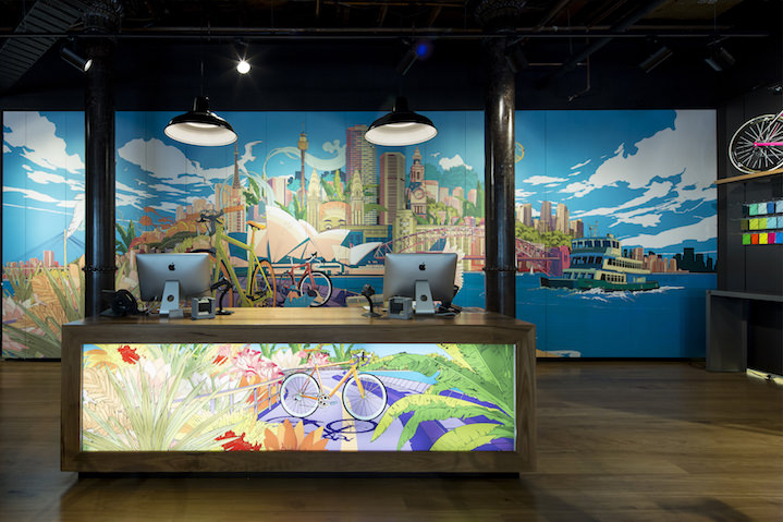 Shan Jiang, Sydney cityscape scene illustrations as large-scale wall mural graphics within a retail reception space.
