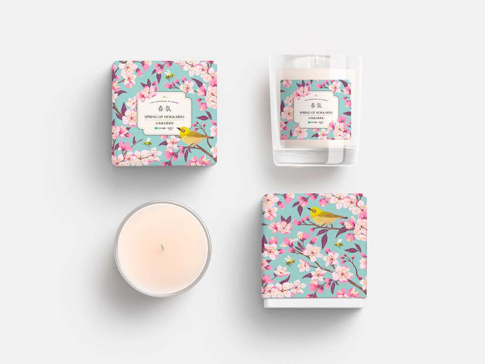 Charlotte Day, Animal and botanical printed packaging for candle, tiny bird details, with bright pink floral detail.