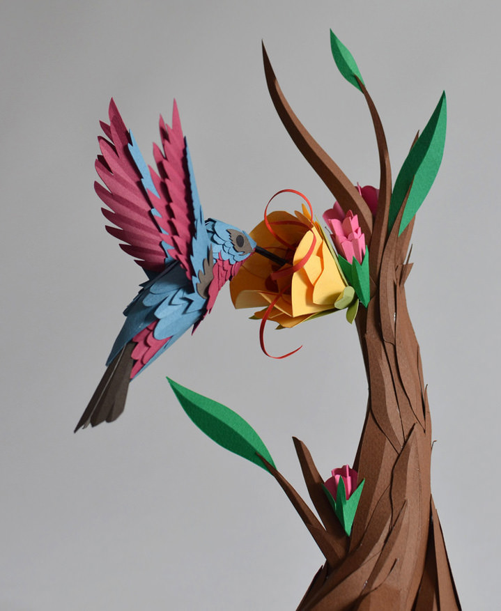 Andy Singleton, Paper Sculpture Of A Humminbird Picking A Flower Attach To  A Tree