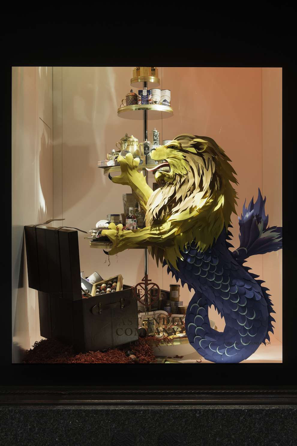 Andy Singleton, Fantastic paper sculpture of a beast with a lion head and a mermaid tail for a window display