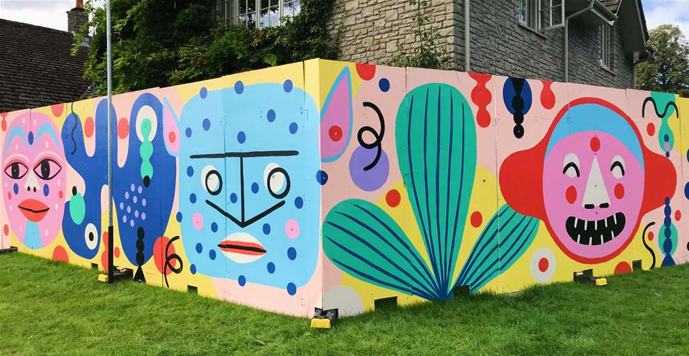 Anna Higgie, Bold and colourful handpainted mural with geometric faces