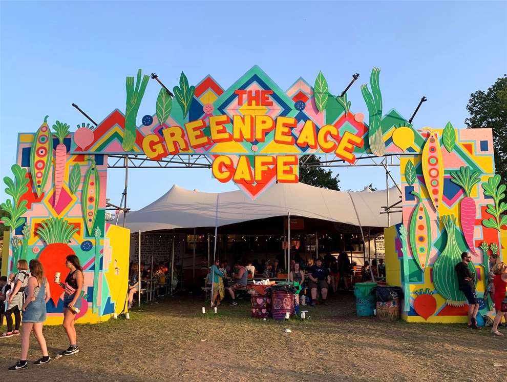 Anna Higgie, Front store mural for Greenpeace cafe at Glastonbury festival. Vegetable illustrations