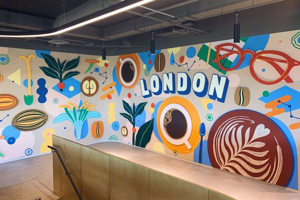 Anna Higgie, Bold, colourful geometric hand painted mural in Starbucks HQ. Illustration of coffee and flora.