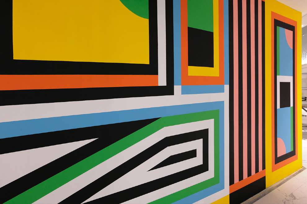 Kitra, Bold and colourful geometric shapes hand painted mural design