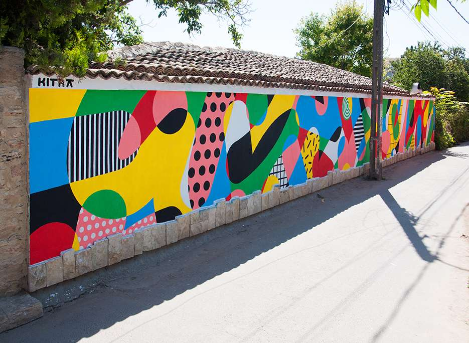 Kitra, Bold and colourful geometric shapes design hand painted on a mural