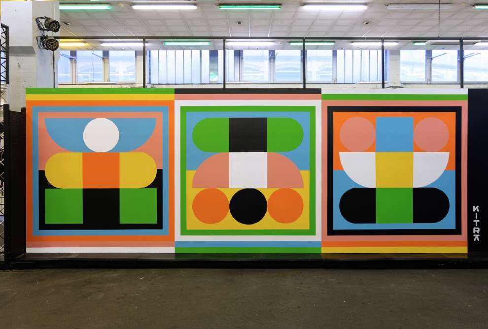 Kitra, Bold and colourful geometric shapes design hand painted on a wall