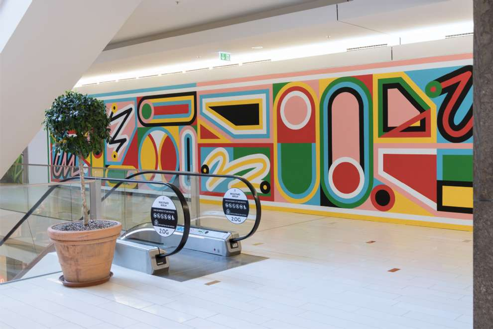 Kitra, Bold and colourful geometric shapes design hand painted in a shopping center