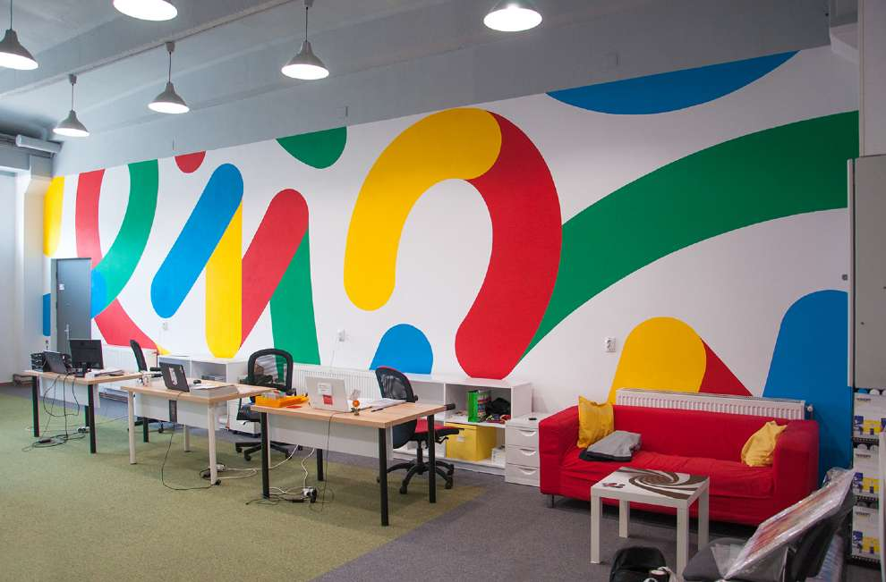 Kitra, Bold and colourful geometric shapes design hand painted on an office wall