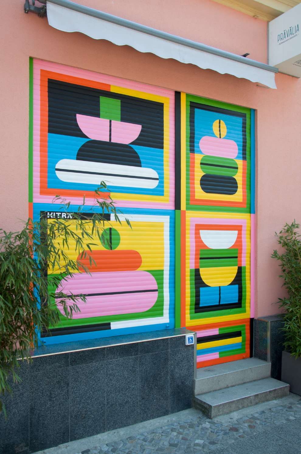 Kitra, Bold and colourful geometric shapes design hand painted on a store