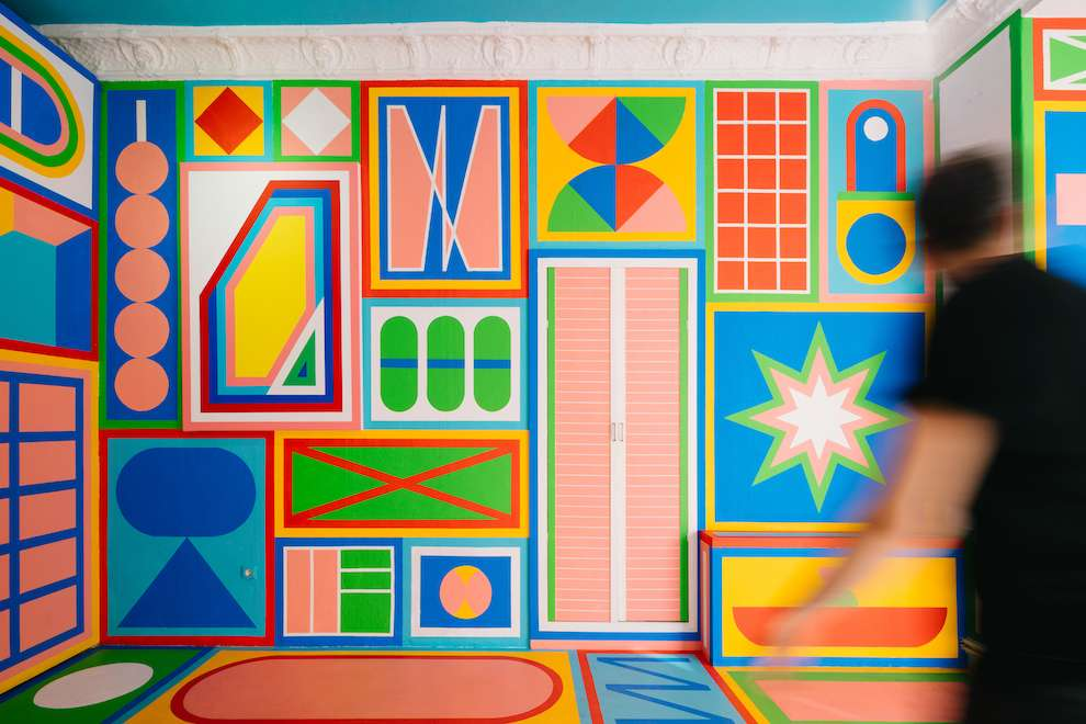 Kitra, Bold and colourful geometric shapes hand painted all over a room