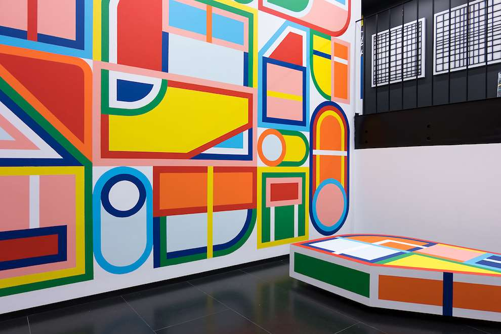 Kitra, Bold and colourful geometric shapes hand painted mural design in museum