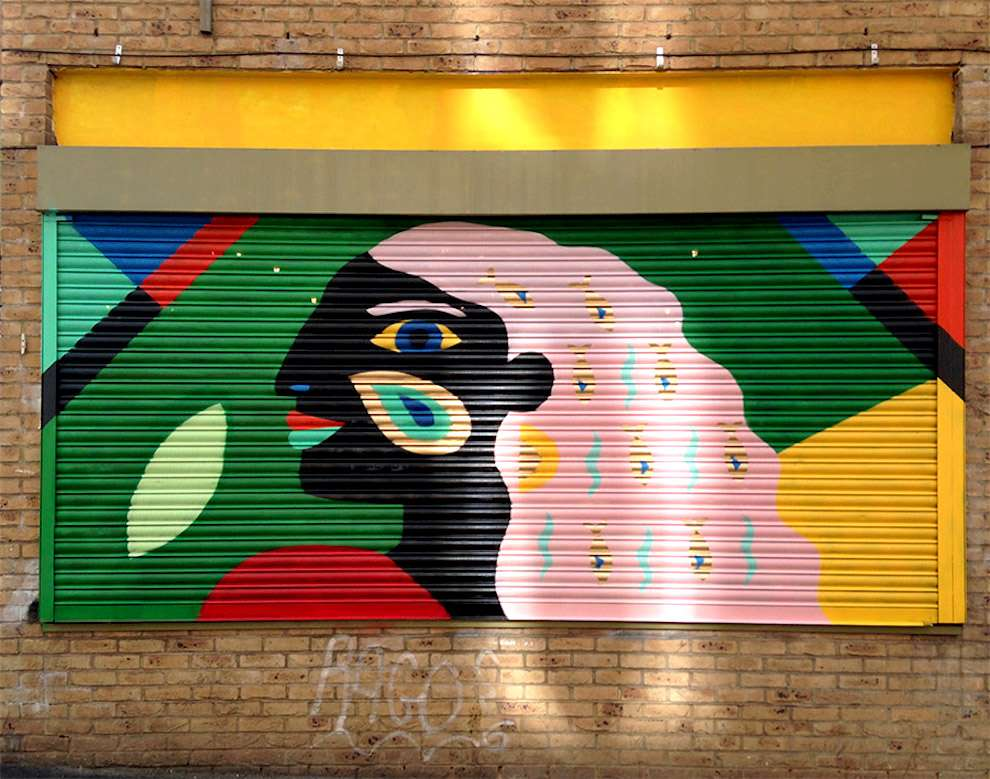 Margaux Carpentier, hand-painted mural of a woman. Bold and colourful
