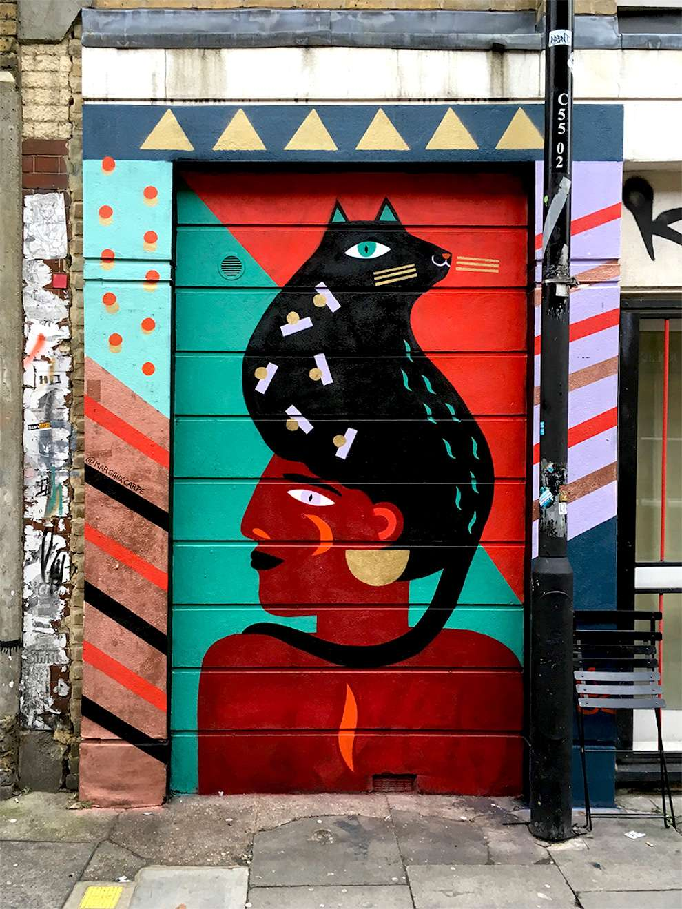 Margaux Carpentier, colourful hand-painted mural of a black woman wearing a cat as a hat