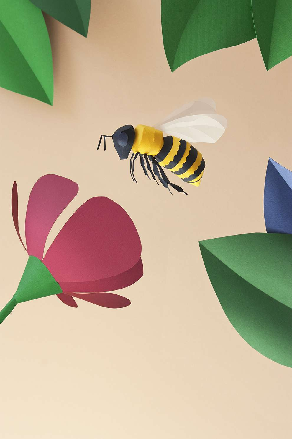 WRK, Paper sculpture illustration of a bee gathering nectar out of a flower