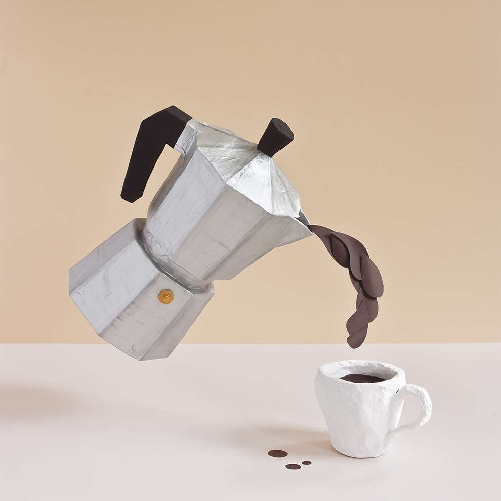 WRK, Papier maché illustration of a coffee maker pouring coffee in a mug