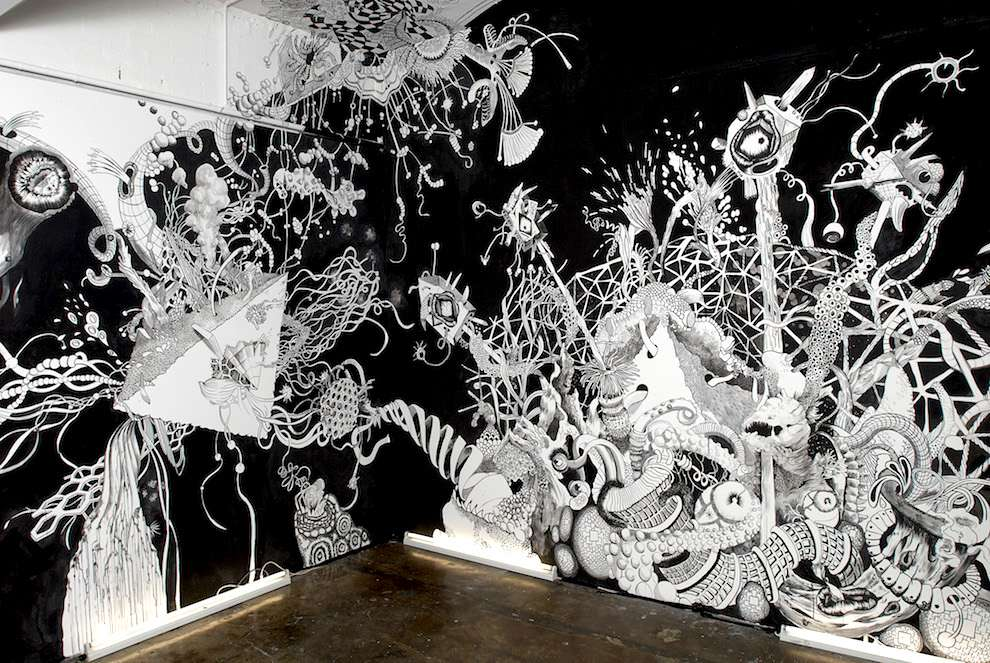 Good Wives & Warriors, Black and white hand painted mural of a surreal space scene
