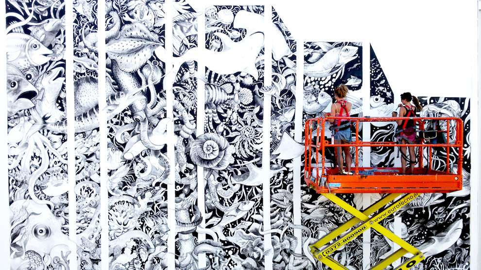 Good Wives & Warriors, Live mural drawing. Black and white under the sea scenery with details illustration of sea species such as fish, shark, octopus...